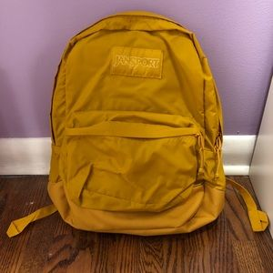 Yellow Jansport backpack